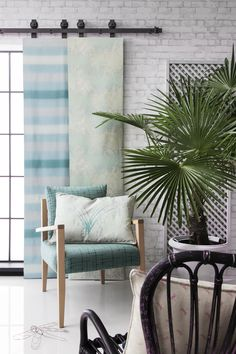 'Dierama' living space. Screen (left) Luxor 'Ocean on Natural', (right) Lana 'Ice Blue on Natural', Chair Temperate 'Kingfisher on Black' with Dierama 'Ice Blue on Natural' cushion, cushion at front Odonata 'Orchid on Natural'