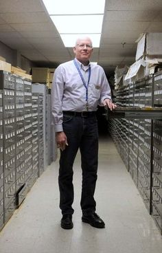 University archivist Barry Cowan stands by drawers of microfilm reels Monday, Mar. 2, 2015, in the archives of Memorial Hill Library.