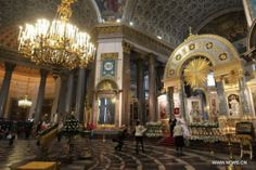 A couple pose for pictures inside the Kazan Cathedral in St. Petersburg, Russia, Sept. 25, 2011