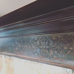 Stenciling and metallic paints on a beautiful mantle!