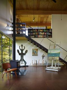 Activist and filmmaker Anna Hoover's home on Puget Sound.  A collaboration with Les Eerkes, principal at Olson Kundig Architects, together they created a 693-square-foot studio in the woods using materials and a building style that treads lightly on our environment.