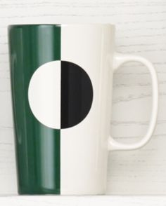 Ceramic coffee mug with a green, black, and white color block design. #Starbucks #DotCollection