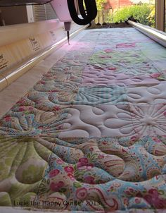 Kerrie's Girly Quilt 1. Whoa! How did I miss this magnificent quilting.