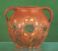 "Bucks County, Pennsylvania redware jar, ca. 1800, with double-sided green and yellow floral decoration, 6 5/8"" h. A related example is illustrated in The Pennsylvania German Collection, pg. 207, fig. 7. The Collection of Lester Breininger"