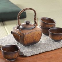 This rich brown, gold and rust Japanese tea set imparts the rustic simplicity of the Japanese pottery craft. Boxed set includes 24 oz. teapot and four, 4 oz. cups.