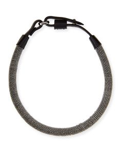 Brunello Cucinelli monili chain-wrapped necklace, Silver/Black Tubular strand of calfskin leather, wrapped in monili jewelry chain. Looped snap clasp.