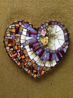 Base in unique shape - maybe a house shape for bisbee? Mosaic glass art - Shelly Armas drove down from Glenwood Springs to join my studio class and create this beautiful heart, at Susan Wechsler studio
