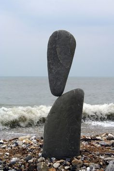 Stone balancing. This is a fantastic image of one of a number of stone balancing pieces erected by Adrian Gray - go check out his work at stonebalancing.com