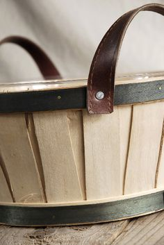 Wood Apple Baskets 10 in. Wood Basket  Green Trim   Leather Handles  $7 each / 3 for $6 each .  Great for a woodland themed party