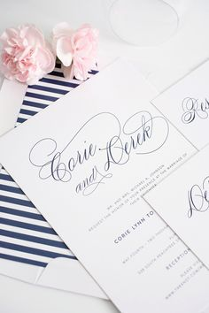 Navy blue wedding invitations with script names and green belly bands