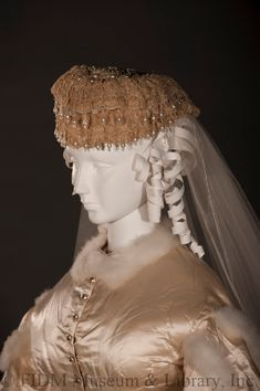 1865-1866, Great Britain - Wedding ensemble - Silk satin, swansdown, linen gauze; Cap - Lace, glass beads, pear-shaped pearls, tulle