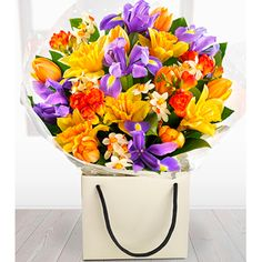 Just Divine - flowers Go for WOW with this incredible spring flower Arrangement. Daffodils, Narcissi, Tulips, Iris and beautifully fragrant Freesia. http://www.comparestoreprices.co.uk/flowers-and-flower-delivery/just-divine--flowers.asp