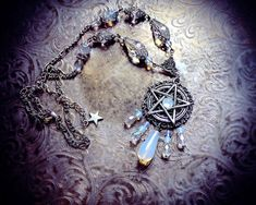 Hey, I found this really awesome Etsy listing at https://www.etsy.com/listing/244007843/white-pentacle-necklace-iridescent-glass