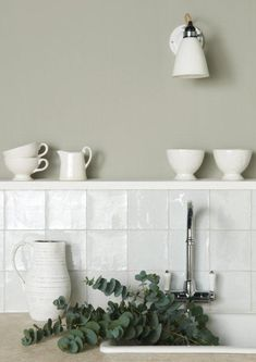 Chalk white tiles from the Metropolitan range which feature a unique lustrous finish. Handmade ceramic tiles which are part of the Residence collection by The Winchester Tile Company. winchestertiles.com
