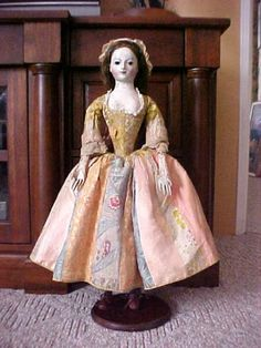 """18th century Queen Anne doll named """"Lady Allen"""".  Her costume is mostly original but some parts of the gown have been replaced with antique fabric.  To my eyes, she's prettier than some of the other dolls of this period."""