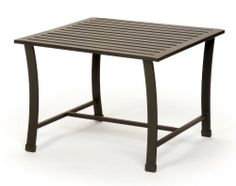 Caluco San Michele Square End Table by Caluco. $316.75. No Assembly required. Extruded & Die Cast Aluminum. Frame Size: 21 in. w x 21 in. D x 19 in. H This end table requires no assembly and is crafted from aluminum tubing with powder coated paint.. Charcoal Grey Color. Sleek lines and refined curves give San Michele a striking contemporary European flair. Finely crafted, powder coated rustproof extruded aluminum frames are exceptionally durable, and deep plush...