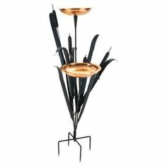 "Attract feathered visitors to your garden or backyard with this charming wrought iron birdbath, showcasing a cattail-inspired silhouette and 2 copper basins.  Product: BirdbathConstruction Material: Wrought iron and copperColor: BlackFeatures:  Powder coatedTwo basins includedDimensions: 50"" H x 36"" W x 36"" D"