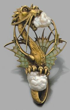 carved dragon pendant in 18k yellow gold set with two baroque pearls, wings decorated with plique-à-jour enamel, French, circa 1900.