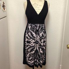 White Over Black Designer Dress VNeckline, white pattern all over lower waistline , very soft material , So So Pretty , Fits 8/10 Sandra Darren Dresses