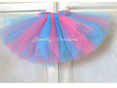 A personal favorite from my Etsy shop https://www.etsy.com/listing/540505177/shocking-pink-and-turquoise-tutu-pink