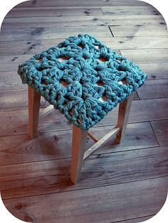 huge granny square stool cover made with many many strands of yarn