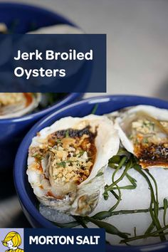 Jerk Broiled Oysters recipe // Serving the grilled oysters on a bed of coarse sea salt helps retain their heat and stabilizes the shell.