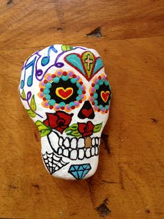 Sugar skull hand painted rock