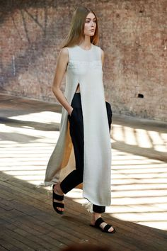 The twins have never been mini-skirt wearing moppets. They've always tapped into a baggy look, which they cleaned up here. So, for instance, long tunics were slit up to the waist to expose finely tailored cropped tapered pants below. - HarpersBAZAAR.com