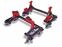 An easy, economical way to work safely under your car and roll it around the shop. Easy-Access to the underside of the car without ramps in the way Much safer than regular jack stands Half the cost of low rise lifts Great for a complete car or just the frame or body Easy to store Works with any combination of axles, frame or unit-body using the interchangeable stands, bars and adjustable rubber pads Constructed from heavy wall square tubing Doubles as a car dolly. H.D. lockable ne...