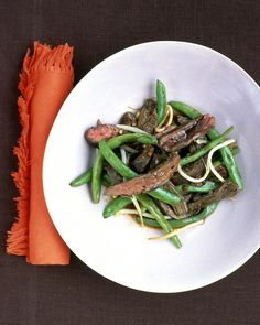Strips of skirt steak are added to the skillet twice in our easy Asian stir-fry: once to brown the meat, and once to simmer them quickly in a sauce of soy, sesame oil, and chilies.