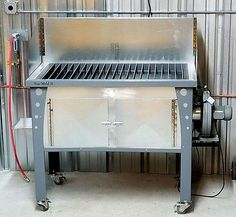 Plasma cutter table. Very nice looking design with down-draft blower.