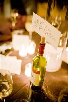 table names - use wine varietals and favorite wines for center pieces, champagne for head table