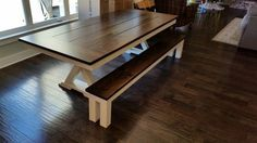 """James+James: James James 6'x45"""" Trestle Table with a traditional top, endcaps, and with an apron, stained in Dark Walnut and a painted ivory base. Pictured with matching Farmhouse Bench."""