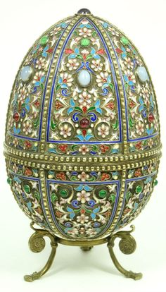 Russian silver-gilt and cloisonne enamel egg and stand