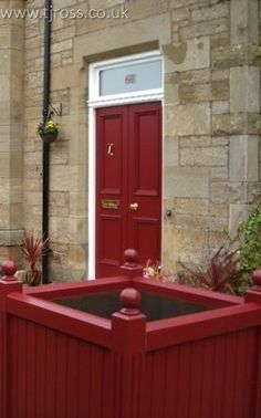 Classic Red Entrance Door with Matching Entrance Planters. External door, painted door Farrow & Ball paint, RAL colours, entrance door