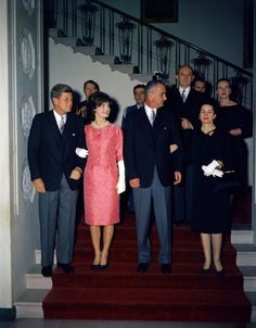 President John F. Kennedy, First Lady Jaqueline Kennedy, Vice President Lyndon B. Johnson, and Lady Bird Johnson attend a reception for members of the Diplomatic Corps, February 1961.
