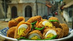 Egg rolls | This Sri Lankan recipe consists of pancakes filled with a fish and potato mixture and hard-boiled eggs, which are crumbed and fried to make tasty parcels.