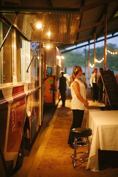 Instead of having guests order up at the food truck window, set up a table in front of the food truck and turn things into faux-buffet-style...