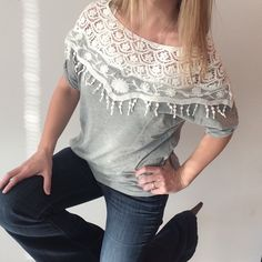 Gray and White Shawl Collar top Gray and White shawl collar top  Pre-owned, great condition, no holes or stains. No size or material tags. Measurements: underarm to underarm flat across is approximately 21 inches. Back of neck to bottom of hem is approximately 21 inches. Tops Blouses