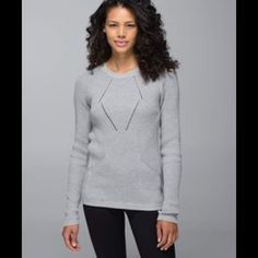 Lululemon sweater Super cute Lululemon gray cotton sweater with thumb holes and logo sewn on back. I took out the tag but I'm pretty sure it's a 6. lululemon athletica Sweaters