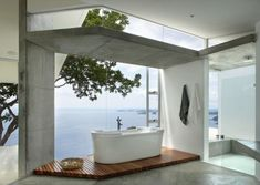 A freestanding #bathtub and a panoramic ocean view provide the ultimate bathing experience. #Cheviot likes this #bathroom