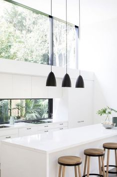 Stunning garden views in this white on white kitchen featuring @caesarstoneau Snow white bench top and window splashback. Builder @element_constructions Photography @chriswarnes homeshelf.com.au help find house plans and build prices suited to your new home requirements, Australia wide. #whitekitchen #designinspo #homeshelf