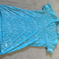 Under armoir blue pattern v neck tee Short sleeve Under Armour brand tee shirt. Blue and white pattern. V neck, more on the lower side. Worn only once, doesn't fit me. (Can go lower with price) Under Armour Tops Tees - Short Sleeve