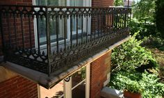 Fancy wrought-iron railings, like those seen here surrounding a a small walk-out on the mansion's second story, show large amounts of rust and need refinishing or replacing, as seen during a tour on Tuesday, May 12, 2015. David Spencer/The State Journal-Register