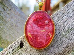 A personal favorite from my Etsy shop https://www.etsy.com/listing/492813098/red-oval-space-pendant-star-pendant
