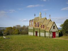 A House for Essex / FAT Architecture and Grayson Perry - The development of a twobedroom guesthouse on the site of an existing derelict farmhouse near the Stour Estuary in Essex. It was designed by the London-based FAT Architecture practice with Britain's best-loved cross-dresser, Turner Prize-winning artist Grayson Perry, as a holiday rental for the Living Architecture company, the idea of Alain de Botton...