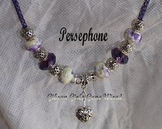 Viking knit wire 28 inches of purple chain. Silver, enameled flowers and purple facets surround the silver heart drop. Perfect for fall