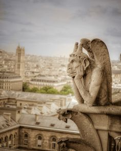 Gargoyle photograph: The bored gargoyle, perched on the bell tower of the cathedral in Paris, just as in Victor Hugo's Hunchback of Notre Dame. Cathedral Architecture, Gothic Architecture, Architecture Details, Paris Photography, Travel Photography, Gothic Gargoyles, Notre Dame Gargoyles, Statues, Tour Saint Jacques