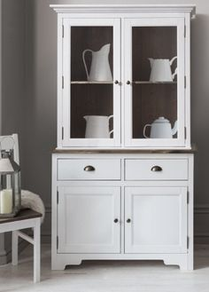 The epitome of chic nonchalance, the Canterbury 2 Drawer Dresser with Glass Doors impresses with its stylish simplicity and understated elegance. Blending a fresh white shade with a pared-back aesthetic, the dresser is the ideal design for contemporary interiors.