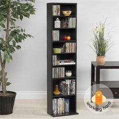 Offering storage for up to up to 261 CDs, 114 DVDs or 132 Blu-ray Discs, this Atlantic Summit 74735727 media storage cabinet features durable wood composite and steel construction and a wide base for added stability. Media Storage Tower, Storage Design, Storage Shelves, Storage Spaces, Game Storage, Rack Shelf, Storage Cabinets, Dvd Holder, Shelf Furniture